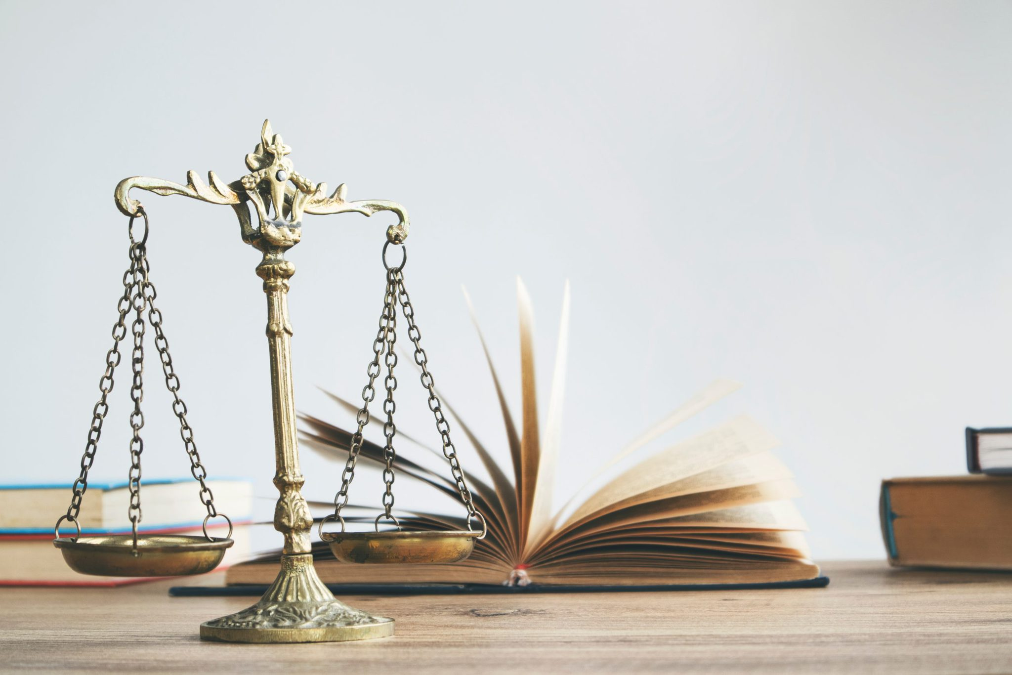 Justice,Legal,And,Jurisprudence,Concept.,Law,Books,On,Lawyer,Desk